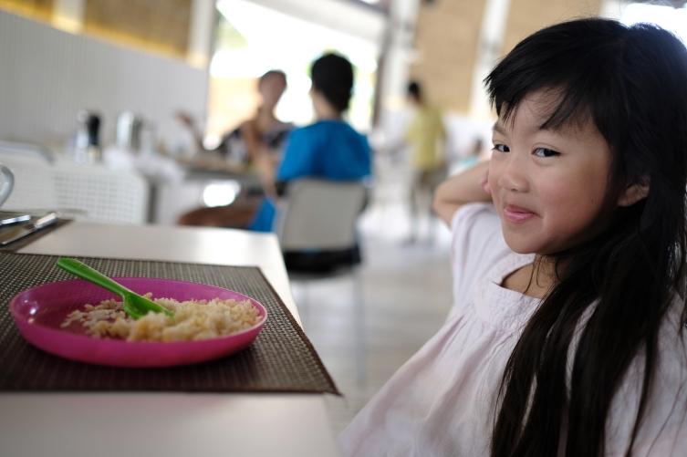 Enjoying her fried rice....
