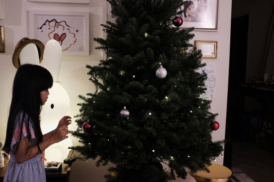 Summer getting all excited decorating the tree..